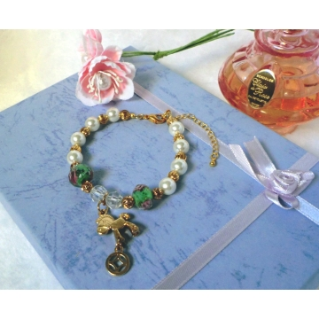 Shell pearl bracelet with gold rocking horse charm
